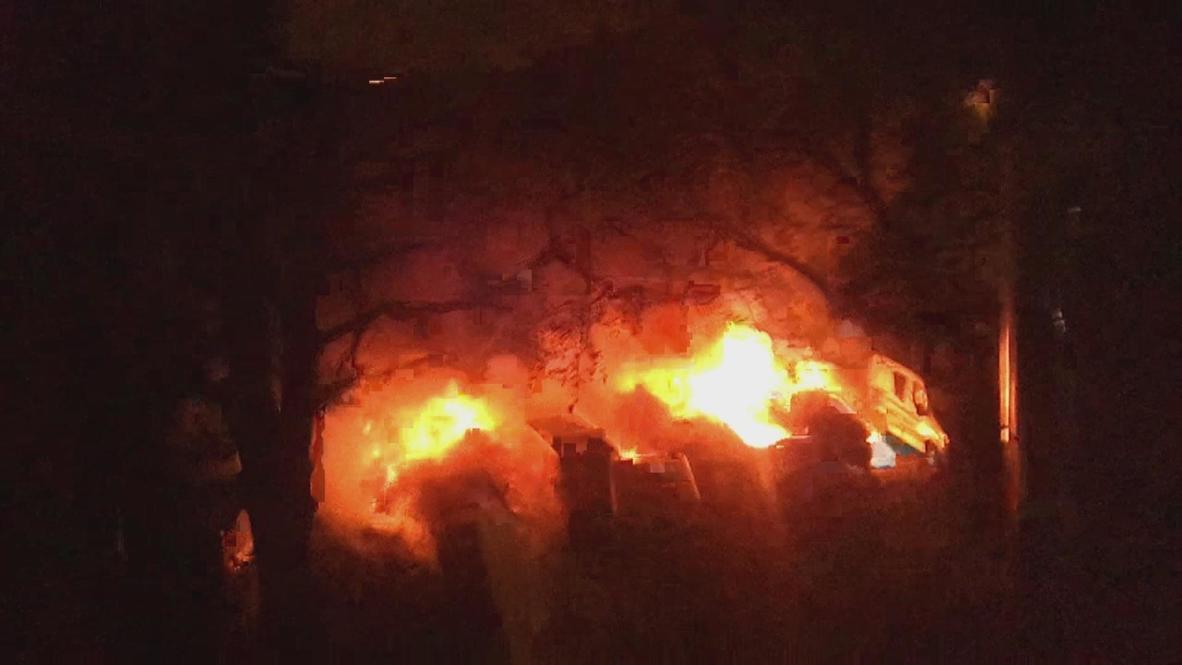 Germany: Police cars burn in German financial hub