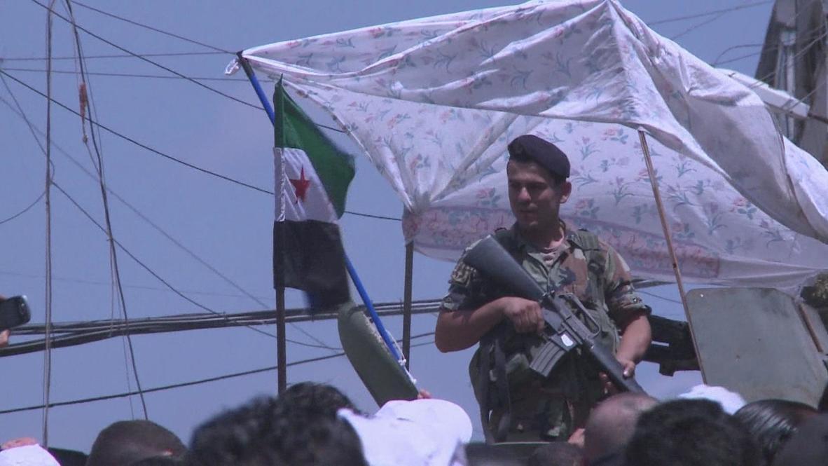 Lebanon: Protesters flee at sound of gunfire