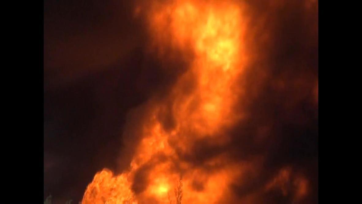 Russia: Man versus fire in massive petroleum plant blaze