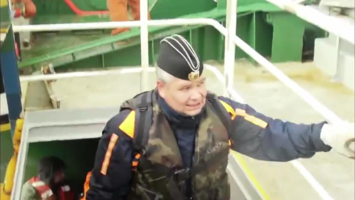 Russia: Sun sets on 'Arctic Sunrise' after coastguard threatens to open fire
