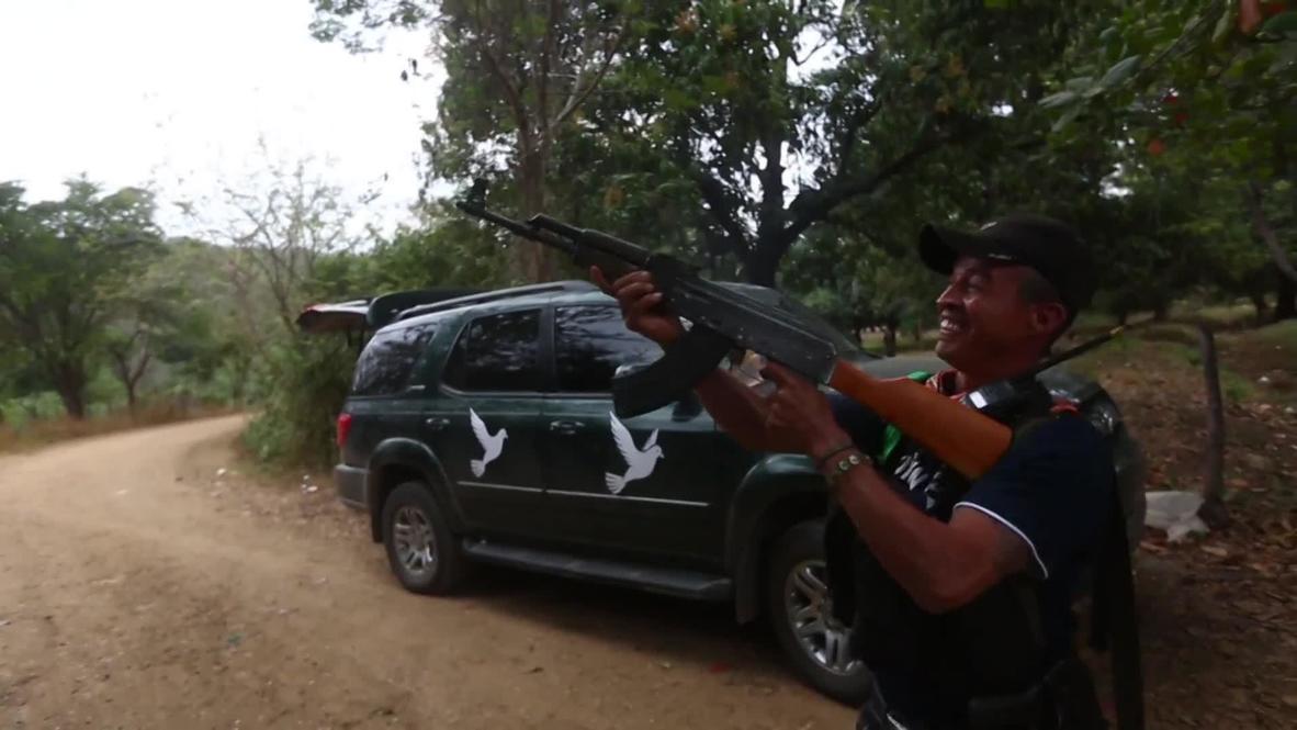 Mexico: Self-defence movement brandishes AK-47s for vigilante training *EXCLUSIVE*