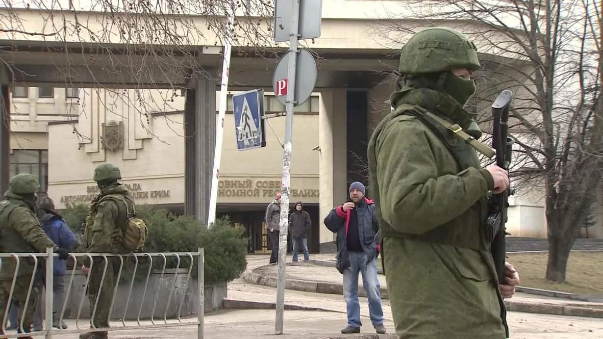 Ukraine: Members of local self-defense units patrol the streets around Crimean Parliament