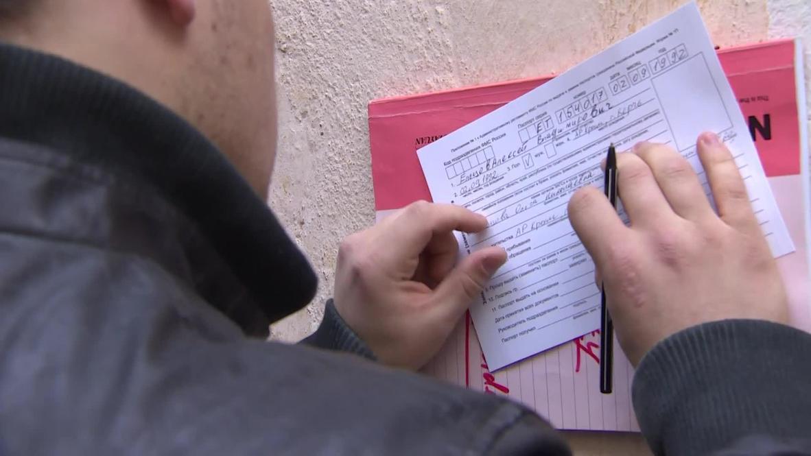Russia: Crimeans swap Ukrainian passports for Russian