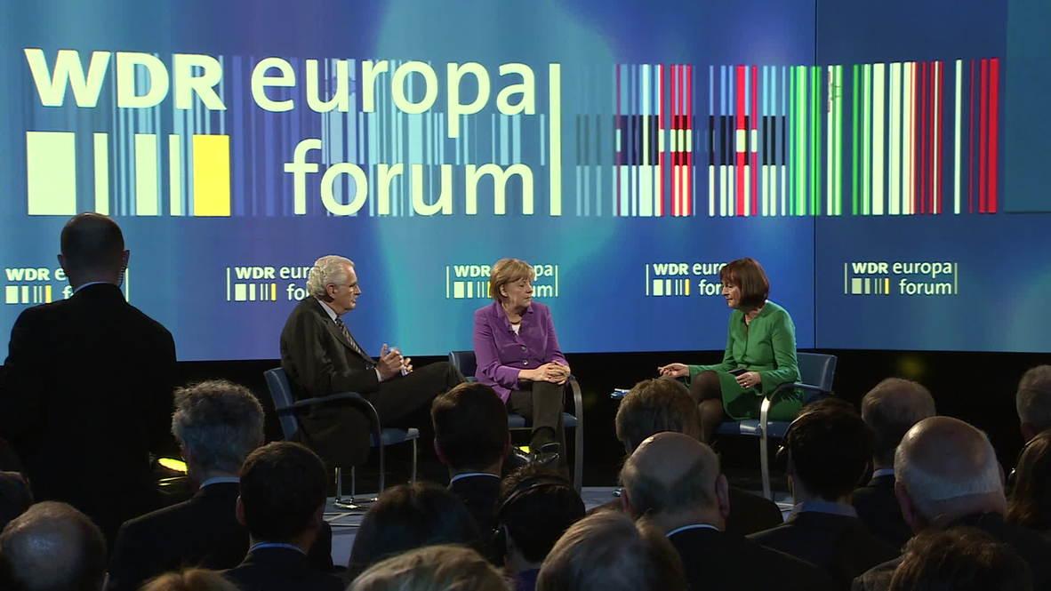 Germany: Merkel teased as 'Putin' call interrupts speech