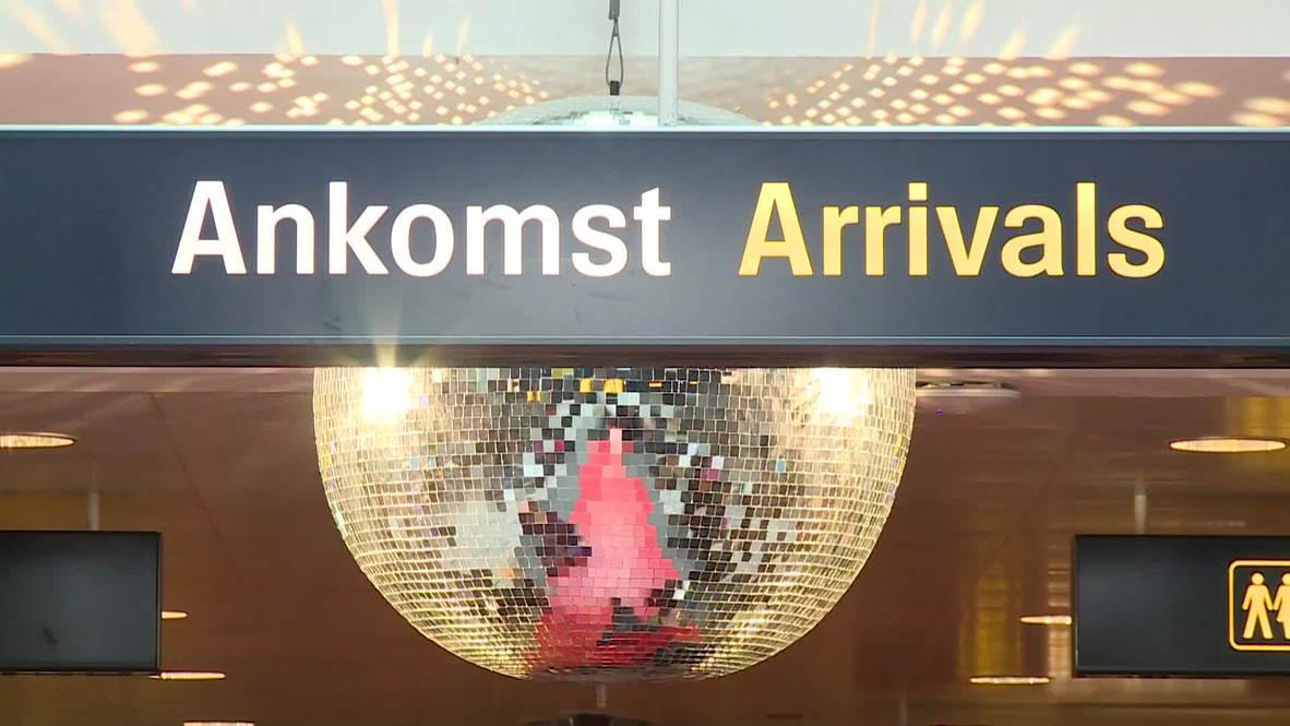 Denmark: Eurovision fans mob Copenhagen airport