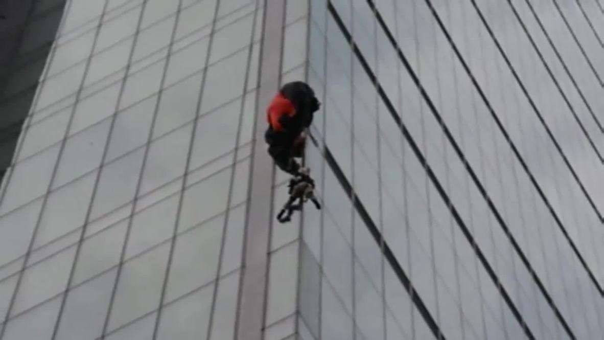 Turkey: Daredevil parachutist stranded on Turkey's tallest building