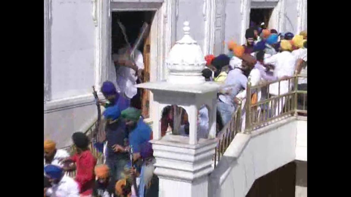 India: Sword wielding Sikhs clash inside Golden Temple