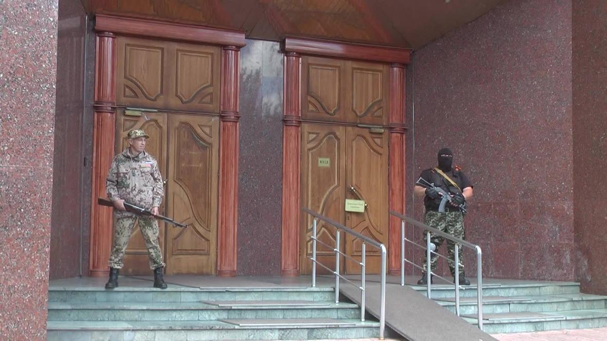 Ukraine: Armed men seize control of National Bank of Ukraine in Donetsk
