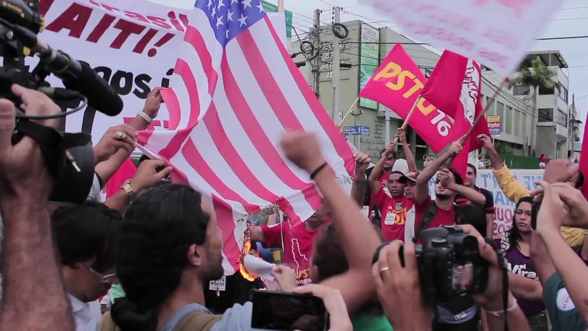 Brazil: Anti-FIFA protesters burn US flag