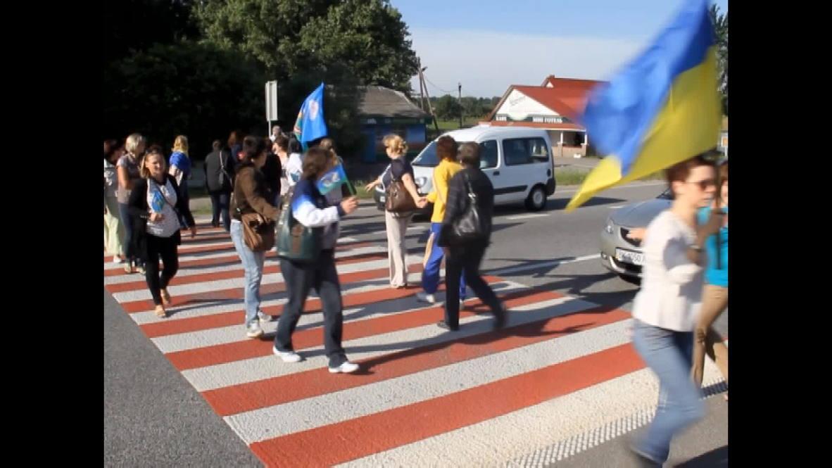 "Ukraine: Women block road, beg Ukrainian army to ""bring their boys back"""