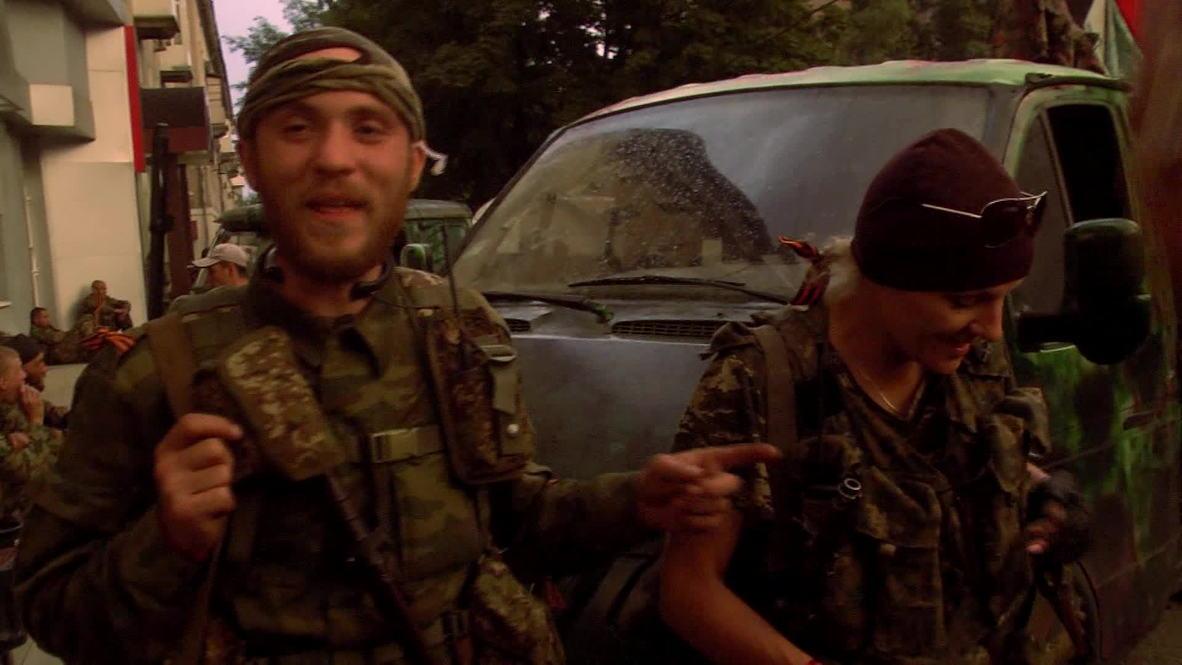 Ukraine: DPR unit members arrive in Donetsk after leaving Slavyansk