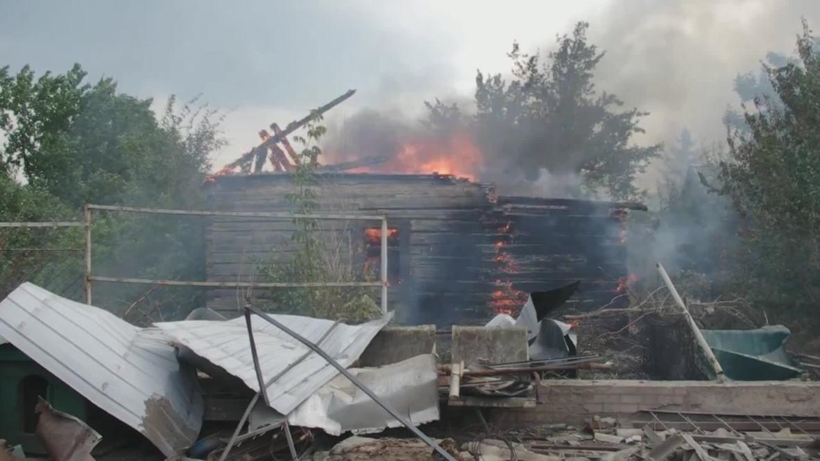 Ukraine: Donetsk residential area burns after heavy fighting