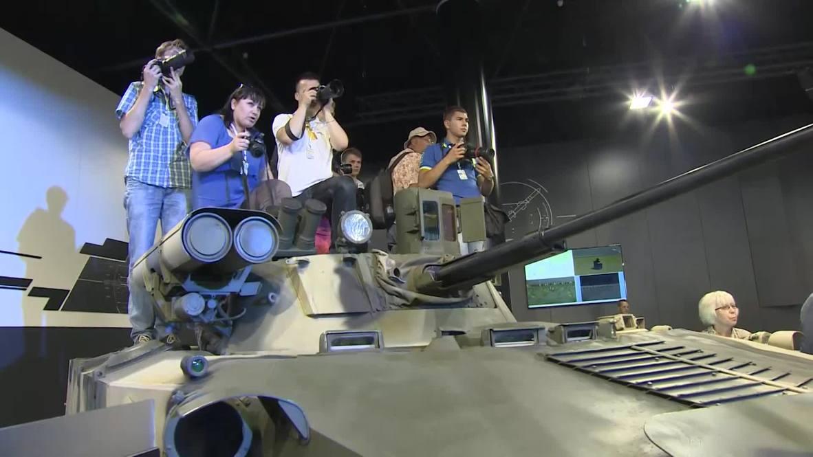 Russia: Steven Seagal wields Russian sniper rifles at OboronExpo 2014