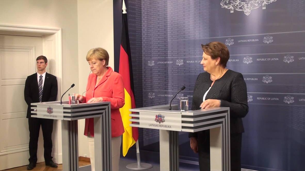"Latvia: ""Imposing sanctions on Russia unfortunately necessary"" says Merkel"