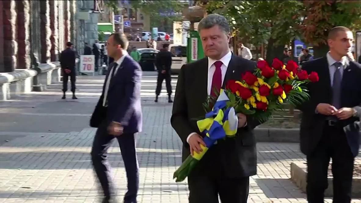 Ukraine: Poroshenko promises peace as protests sweep Kiev