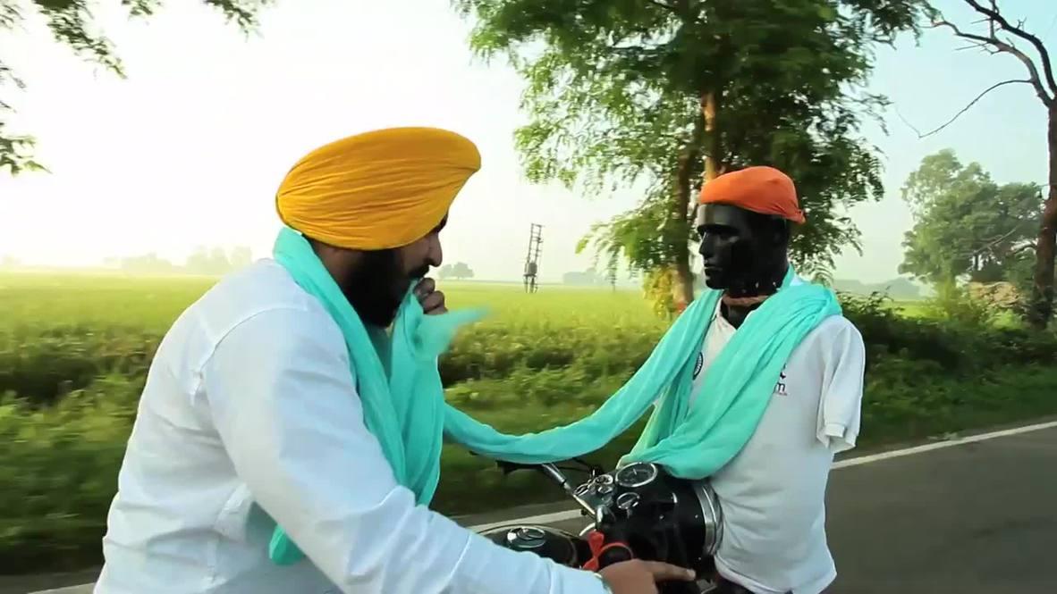 India: Turban-meister! See man wrap turban on moving motorcycle