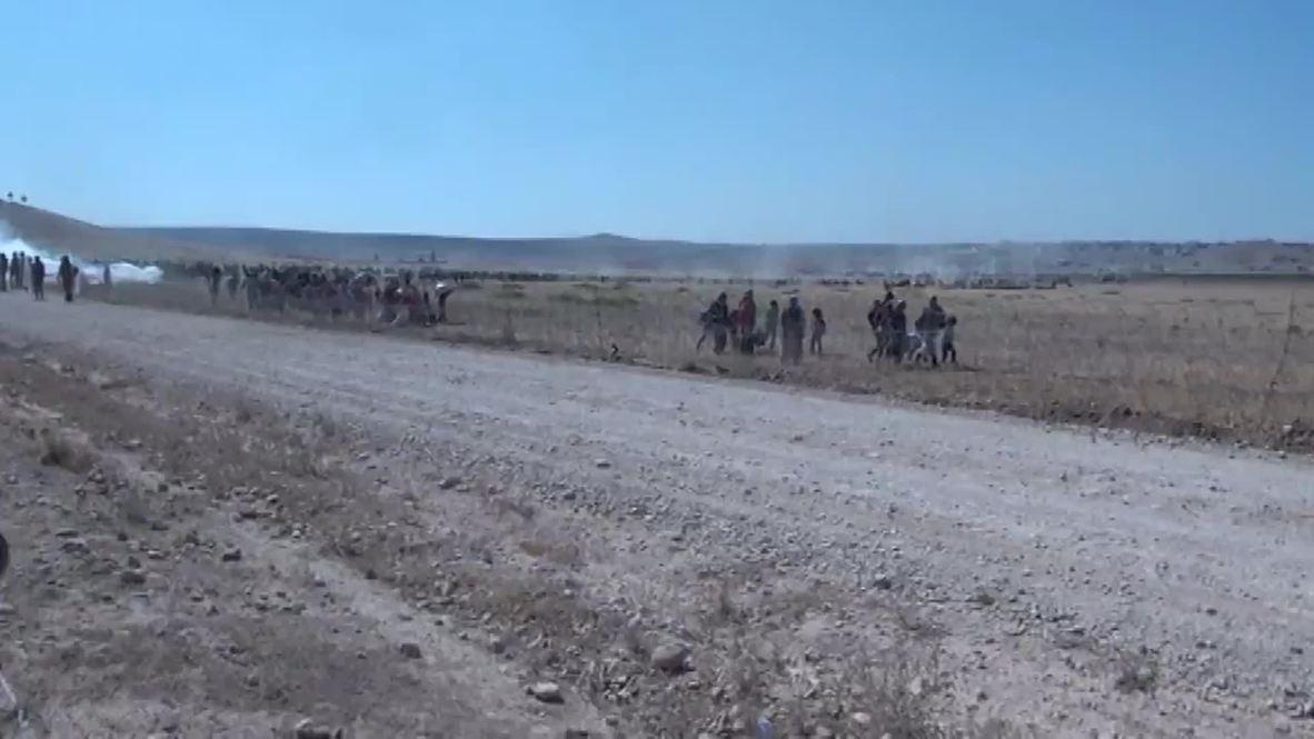 Turkey: Thousands of Kurds hop Turkish border to escape IS14