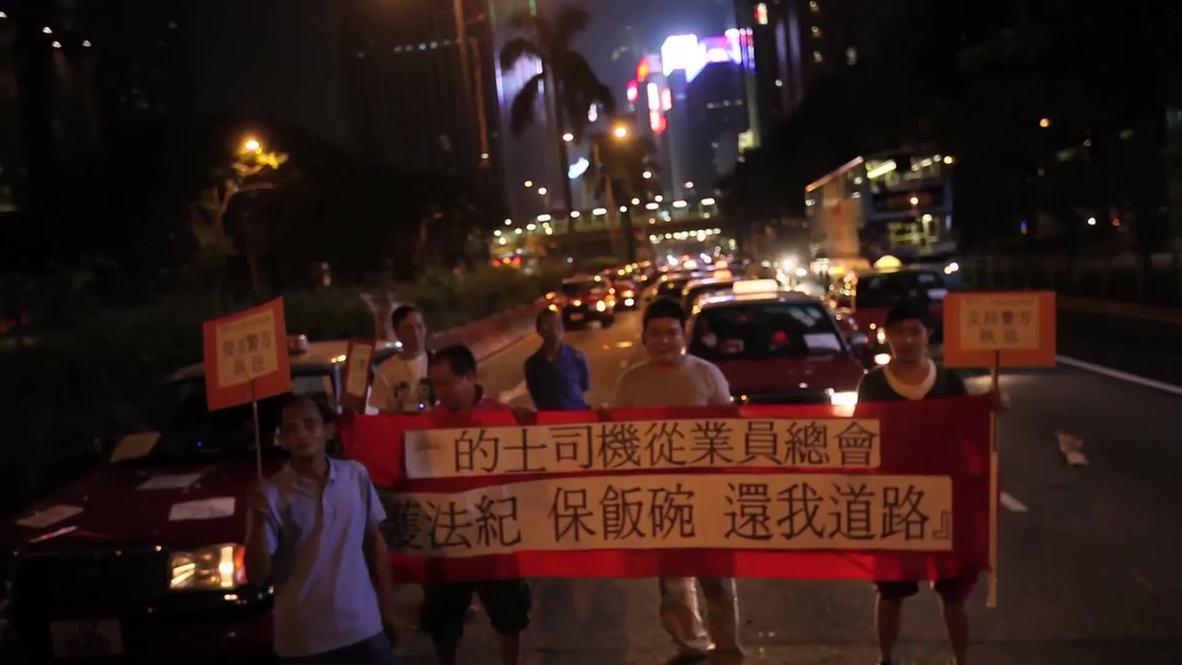 Hong Kong: Angry cabbies GRIDLOCK HK's busiest street