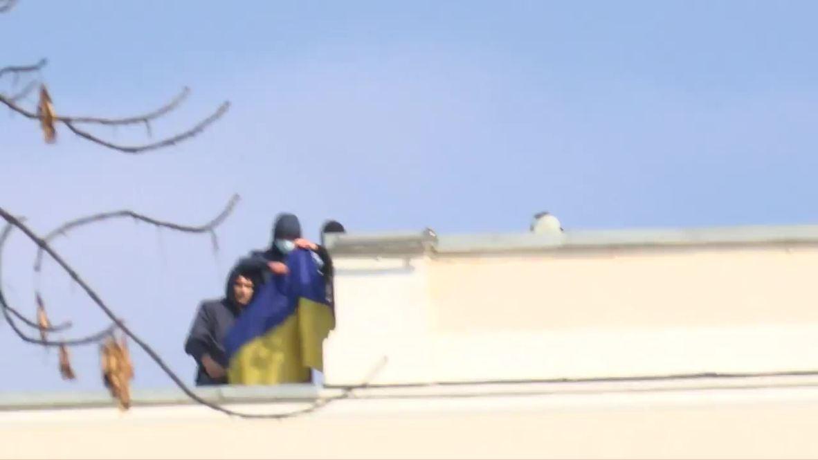Ukraine: Protesters seize ministry rooftop, unfurl national flag