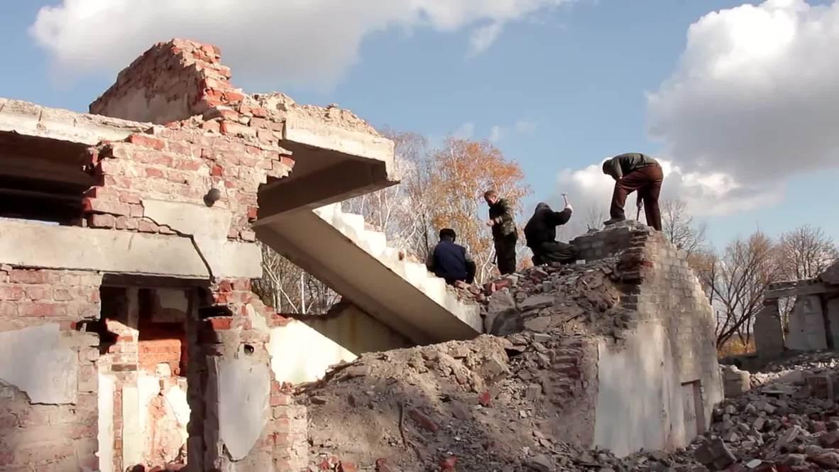 Ukraine: Army POWs deployed to reconstruct war-torn Ilovaysk