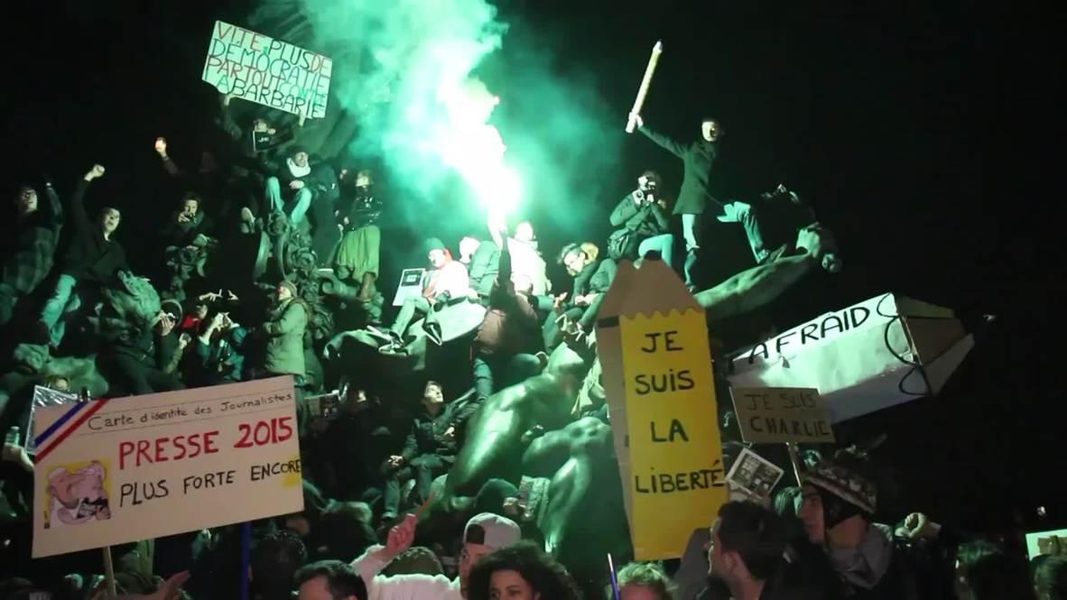 France: Watch Charlie Hebdo demonstrators climb 'The Triumph of the Republic'
