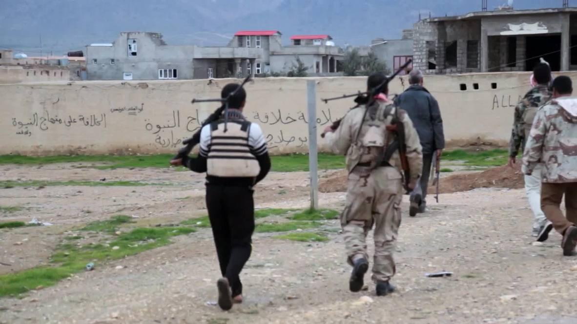 Iraq: Yazidi fighters liberate 'corpse-strewn' town