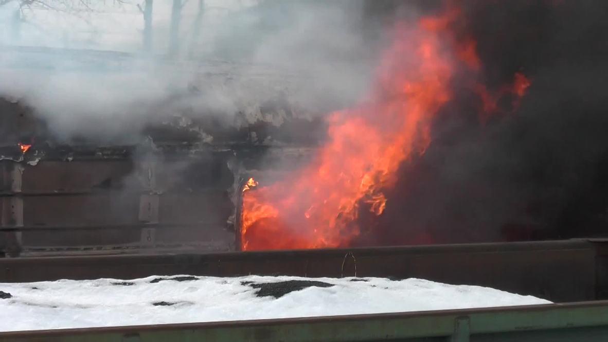 Ukraine: Train catches fire amid fighting near Debaltsevo
