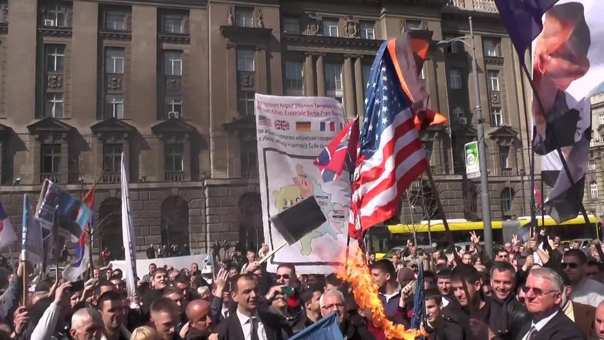 Serbia: Watch anti-NATO protesters burn EU & US flags