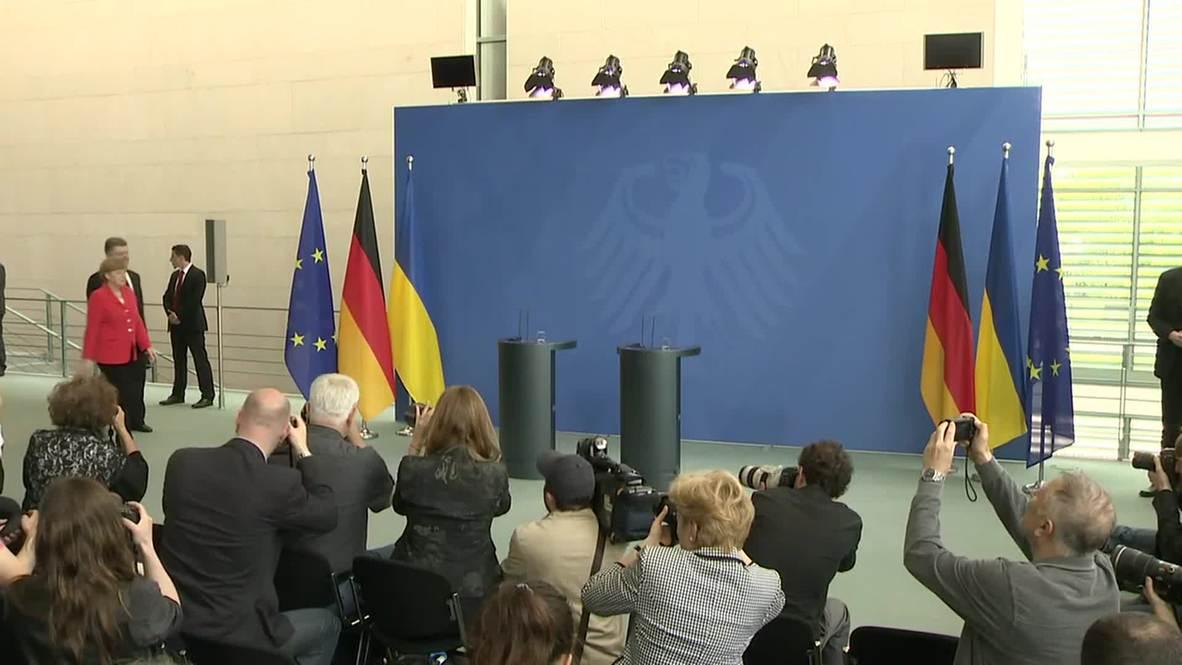 Germany: Poroshenko promises demilitarization of conflict zones