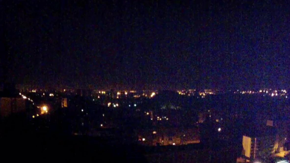 Ukraine: Flares illuminate Donetsk skyline as ceasefire violations continue