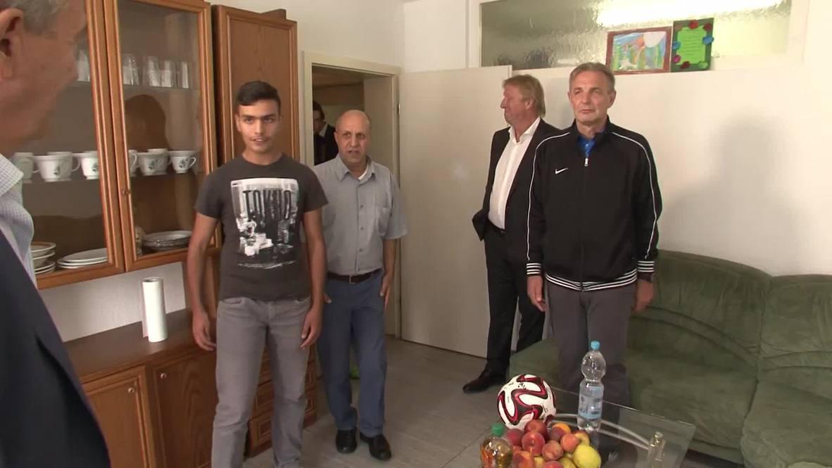 Germany: Football Association president visits refugee shelter
