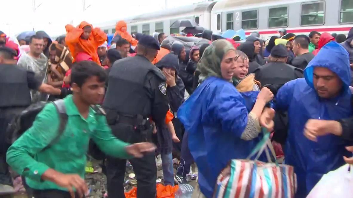 Croatia: Families divided as refugees struggle to board train
