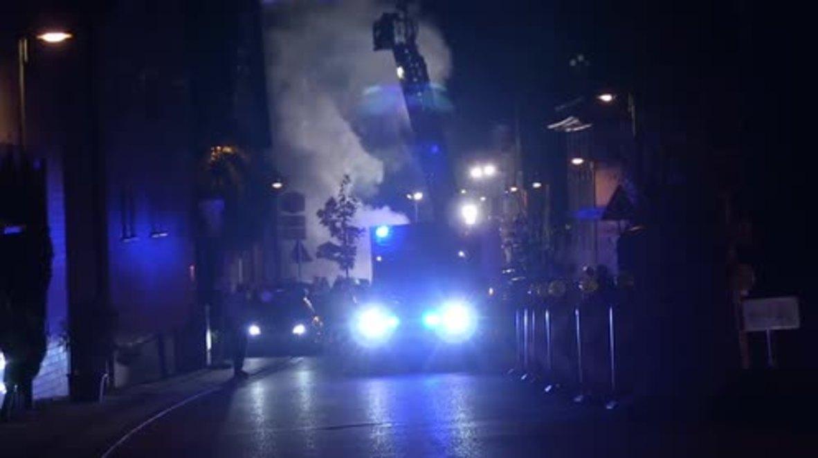 Germany: Refugee shelter evacuated as blaze destroys adjacent building