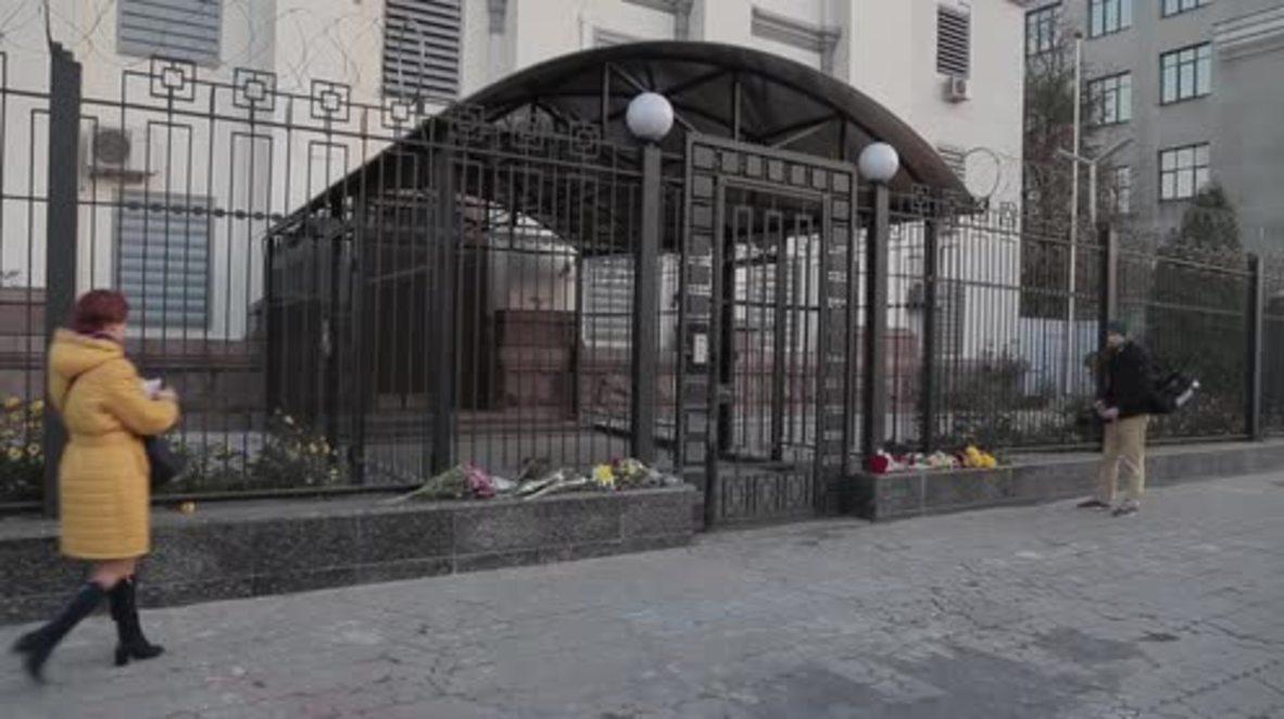 Ukraine: Plane crash mourners place flowers outside Russian embassy in Kiev