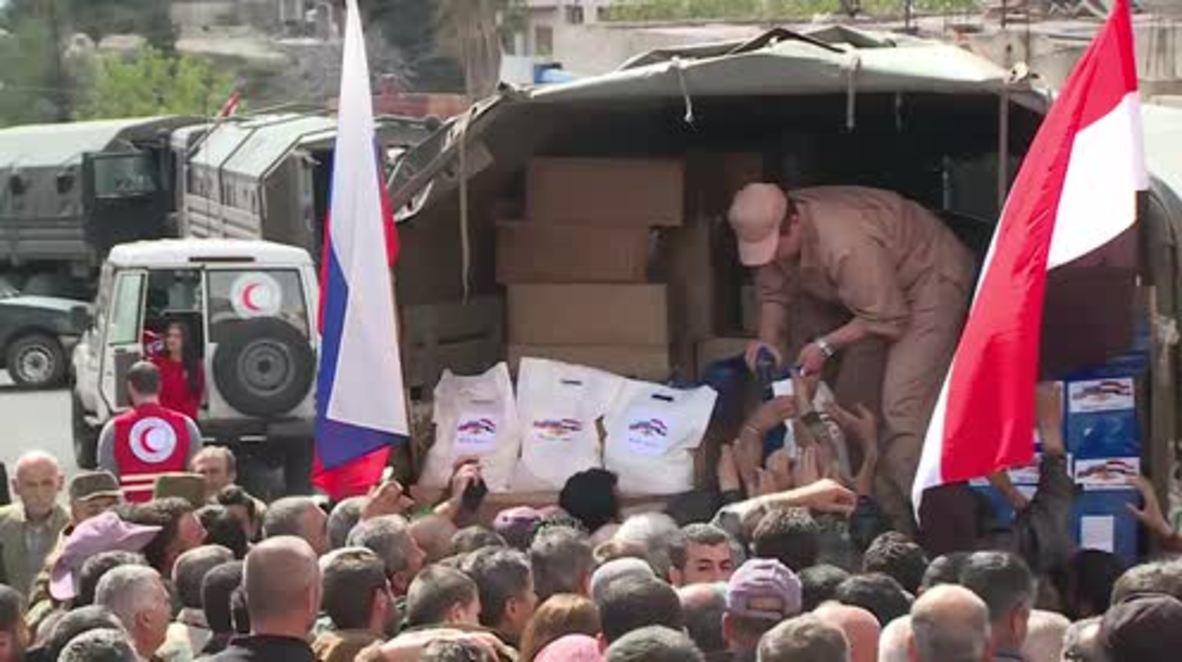 Syria: Humanitarian aid convoy reaches Turkmen village in Latakia