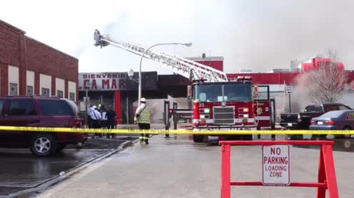USA: Fire crews react after blaze engulfs Chicago flea market