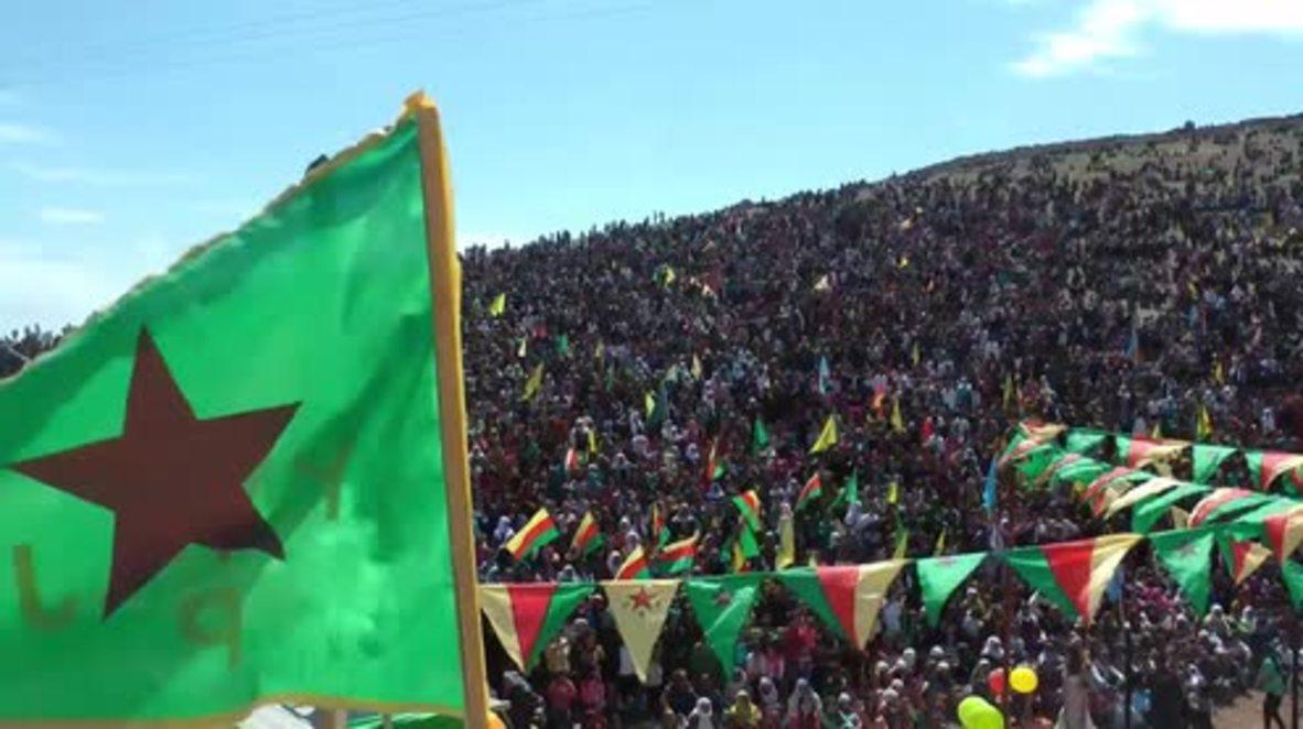 Syria: Thousands of Kurds celebrate Newroz on Mishtenur hill in Kobane