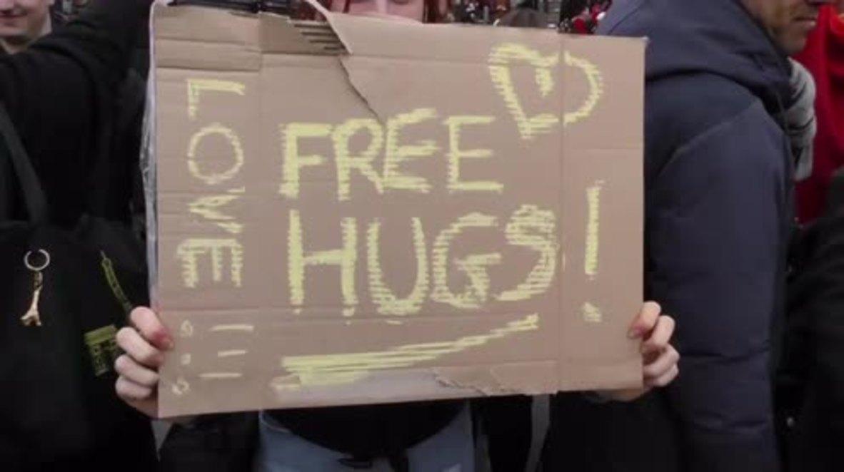 Belgium: Brussels residents offer free hugs on Place de la Bourse