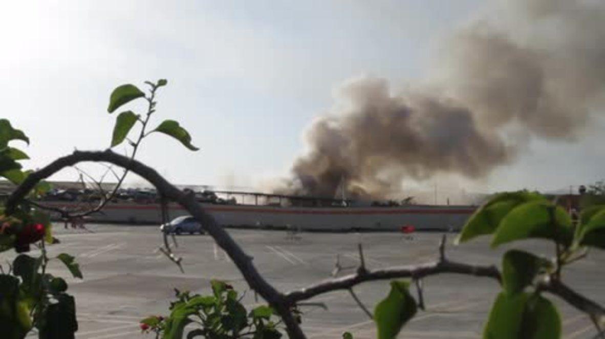 USA: Massive blaze at LA junkyard sends up mile-long plume of smoke
