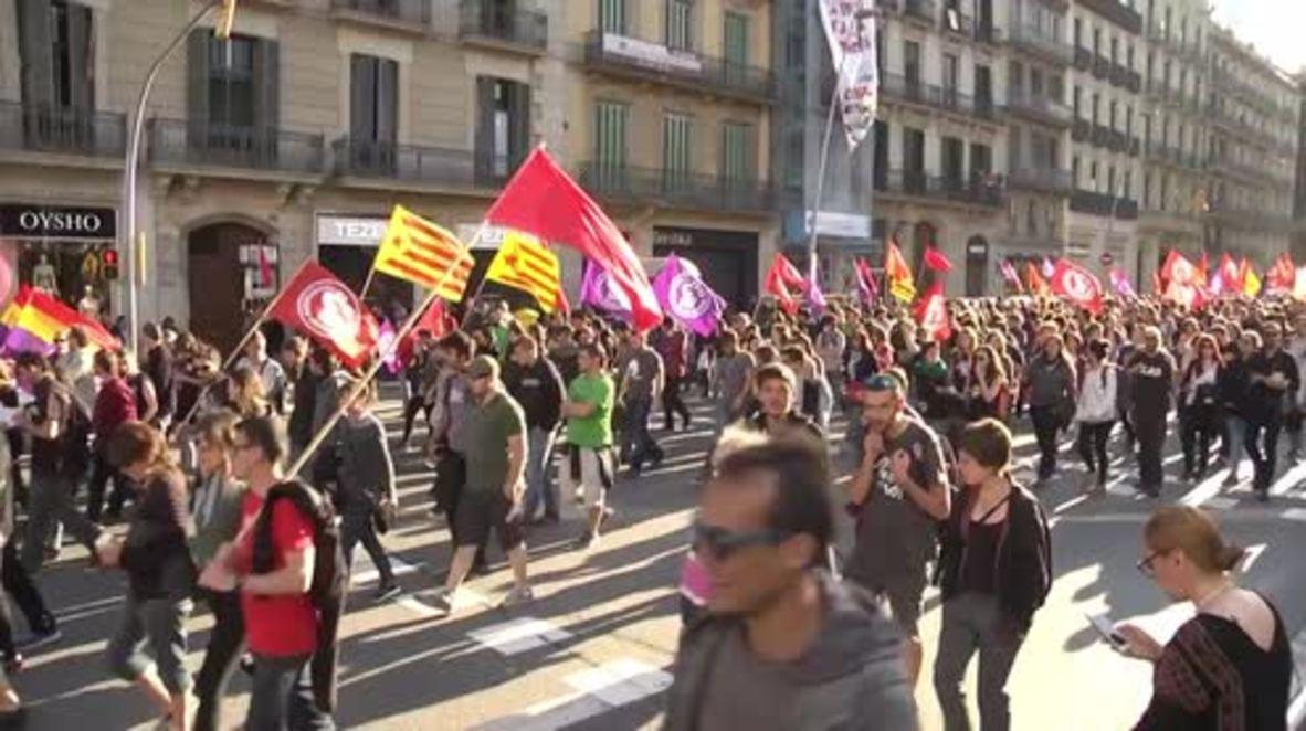 Spain: Hundreds rally through Barcelona on Labour Day