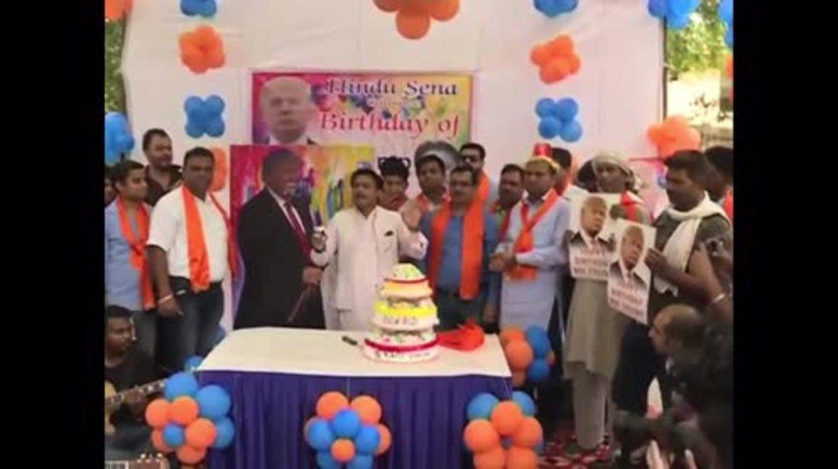 India: Hindu nationalist group celebrates Trump's birthday, feeds his portrait cake