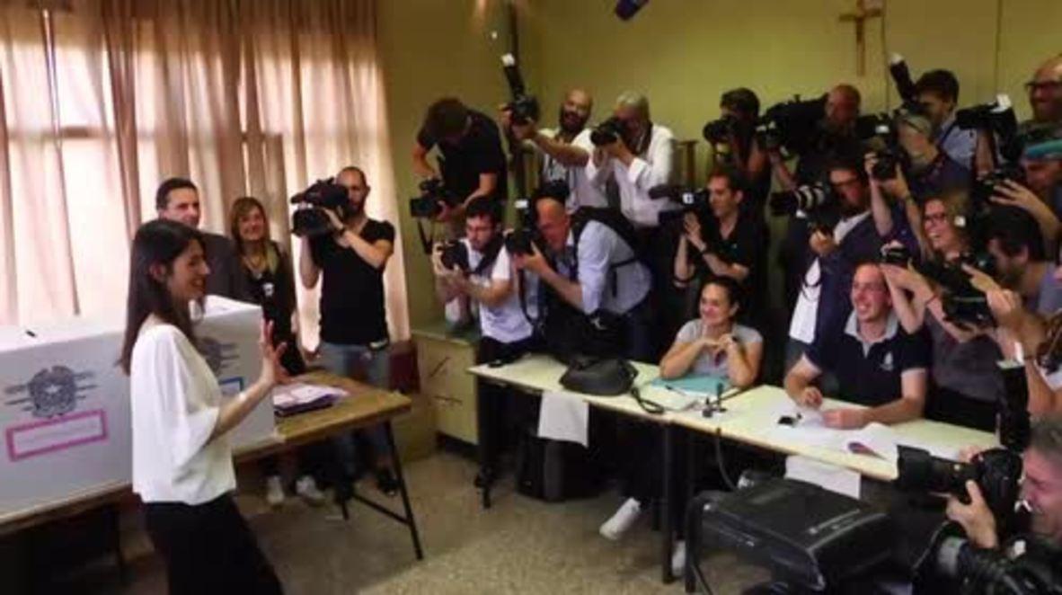 Italy: Rome mayoral election 1st round winner Raggi casts 2nd round vote