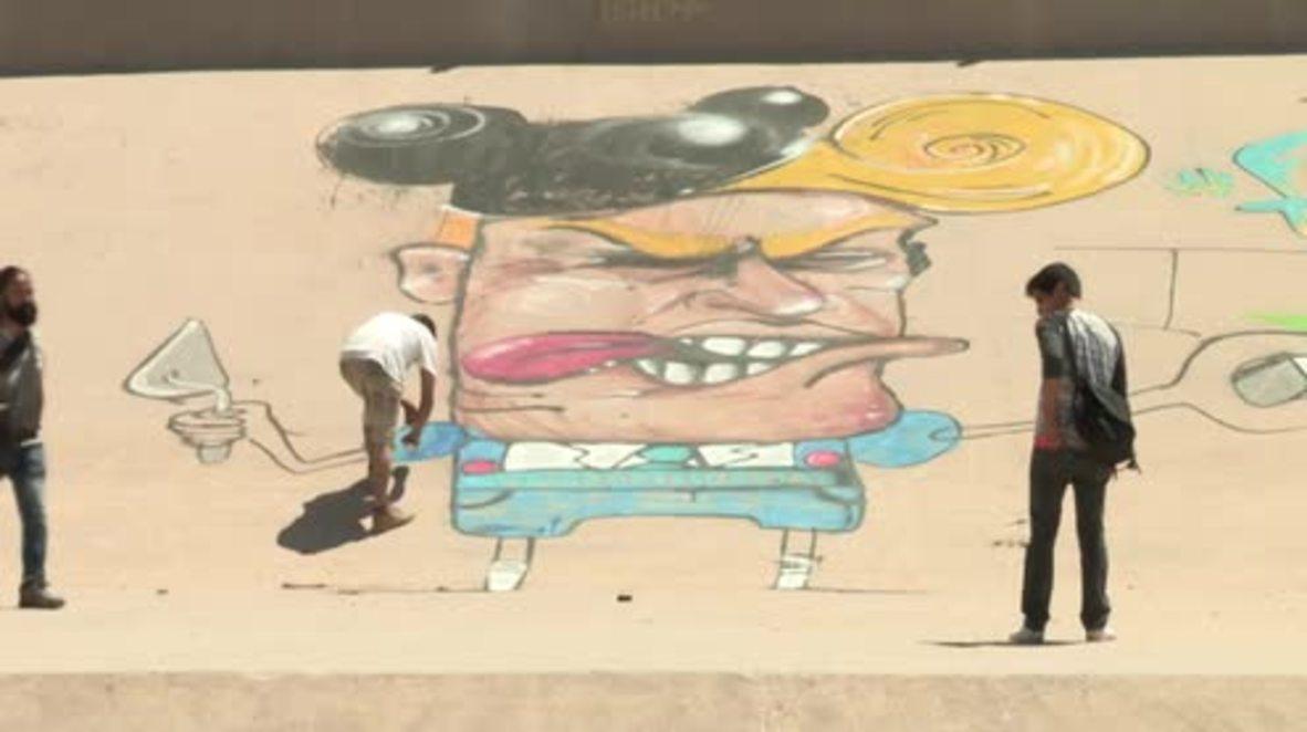 Mexico: 'Fuck Trump' - Artist draws anti-Trump mural on Mexican-US border