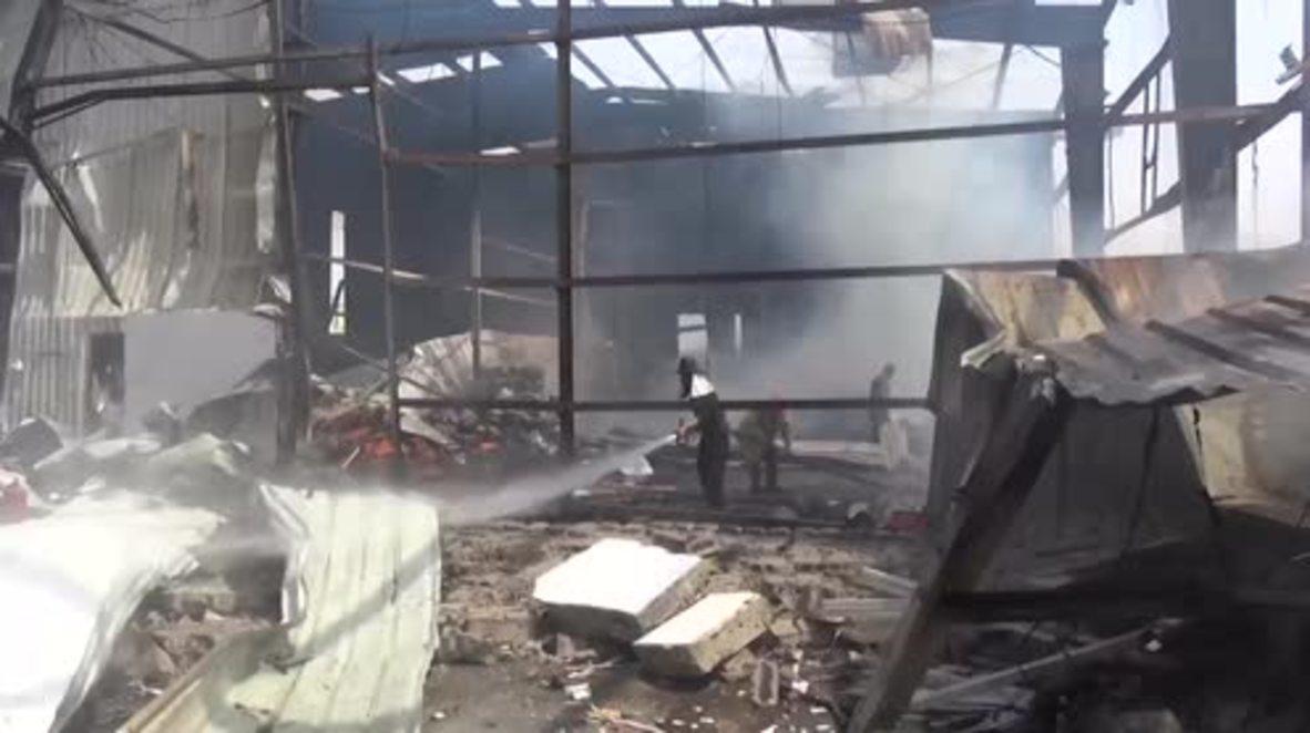 Yemen: Firefighters fight blaze following Saudi-led coalition airstrikes