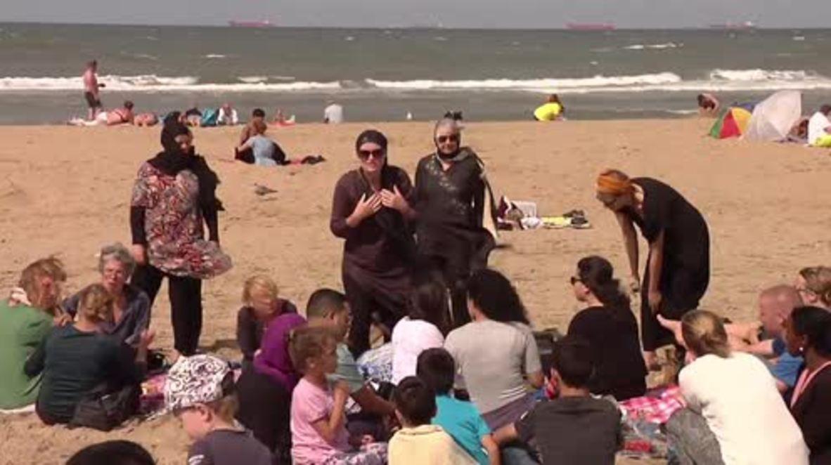 Netherlands: Beach-goers hold 'burkini' solidarity protest in Scheveningen