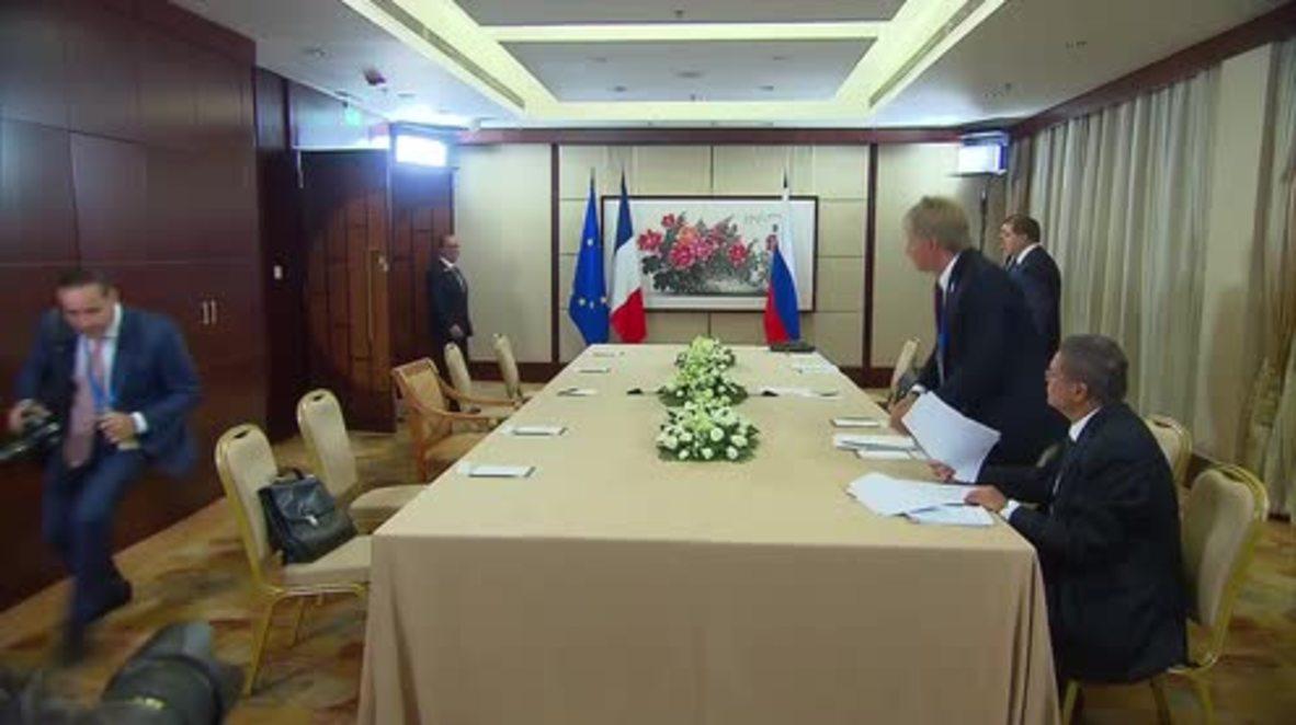 China: Putin and Hollande talk Ukrainian and Syrian conflicts
