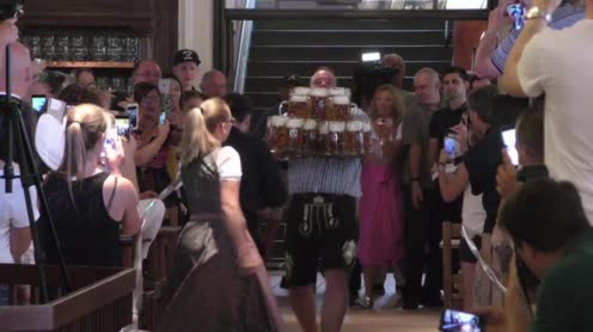 Germany: Beer juggling Bavarian lugs 27 MASSIVE mugs 40m, breaks world record