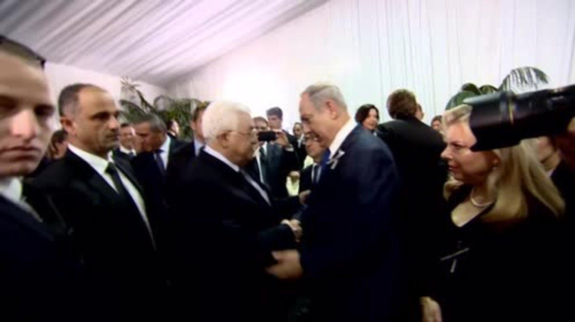 Israel: Abbas and Netanyahu exchange 'historic' hand shake at Peres funeral