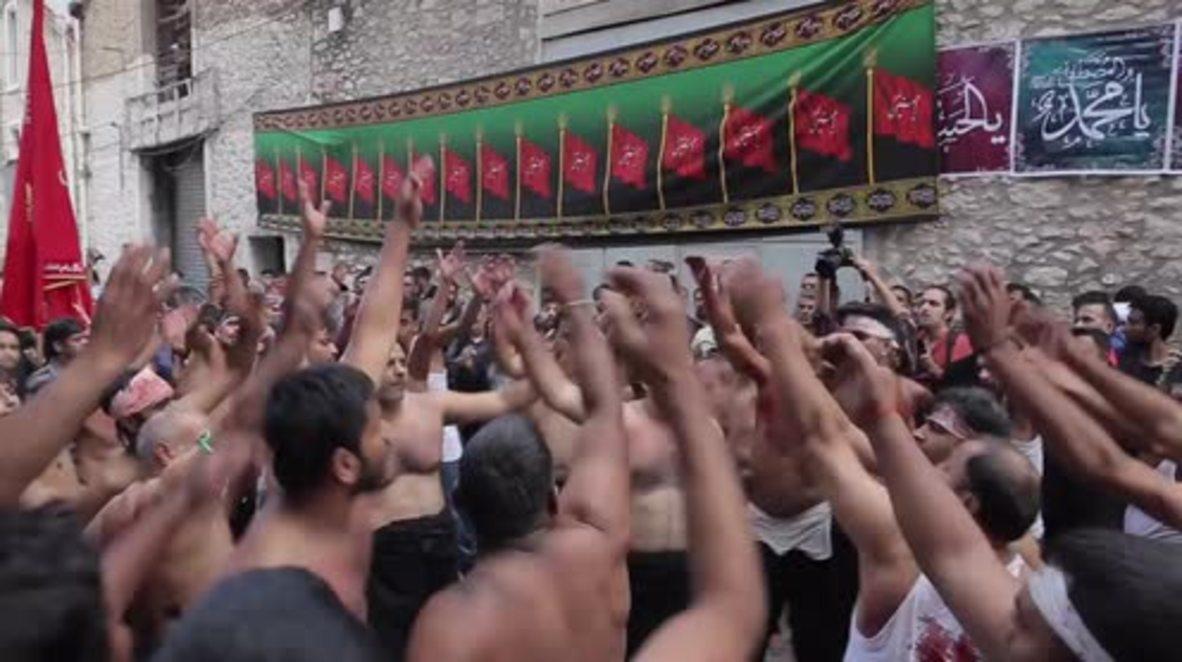 Greece: Shia Muslims self-flagellate to mark Ashura in Piraeus *GRAPHIC*