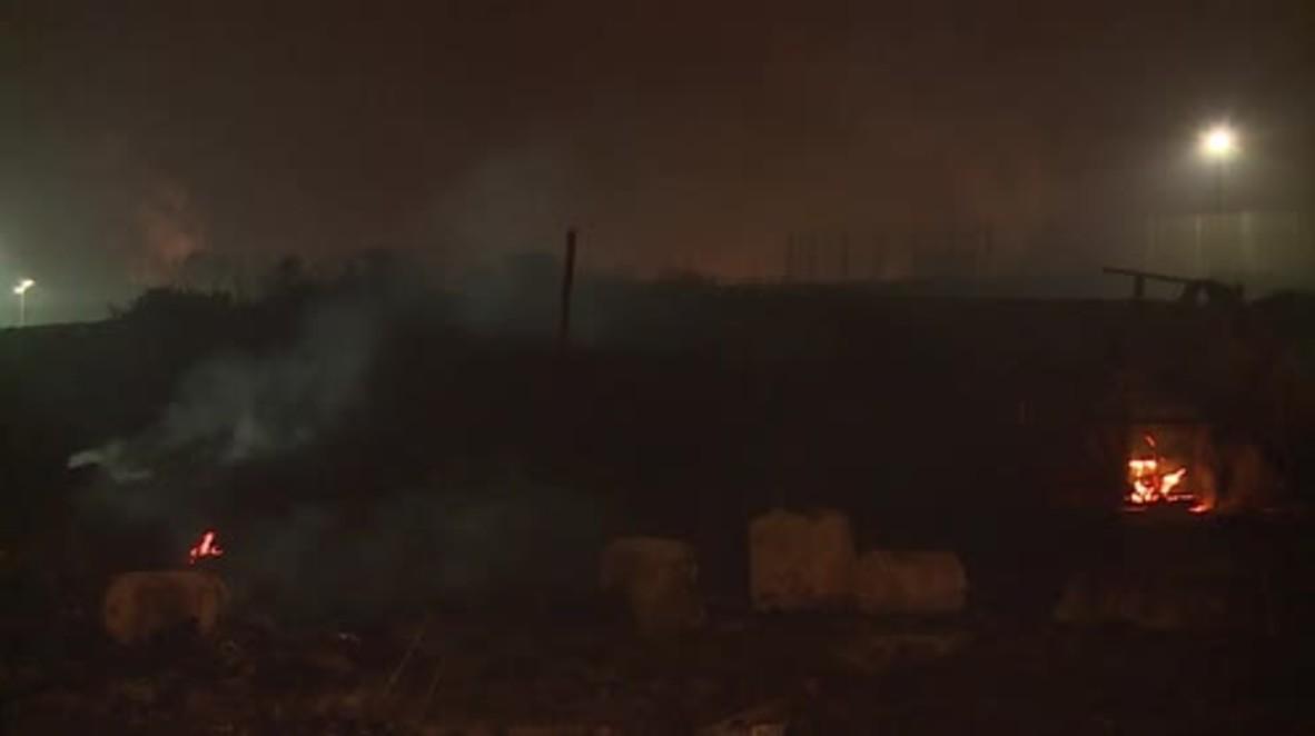 France: Calais refugee camp smoulders after massive blaze during eviction